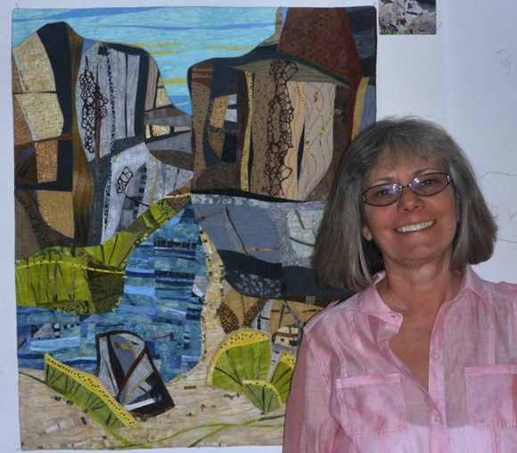Donna Rice with her Two Rivers Three Sisters quilt panel.JPG